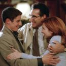Jim's Dad (Eugene Levy) congratulates the groom, Jim (Jason Biggs) and bride-to-be, Michelle (Alyson Hannigan)