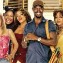 (Left to right) Mena Suvari, Bryce Wilson, Keshia Knight Pulliam, Alicia Silverstone, Laura Hayes, Golden Brooks, Djimon Hounsou, Alfre Woodard, Andie MacDowell, and Kevin Bacon. ©2005 Beauty Shop/Metro-Goldwyn-Mayer (MGM). - 432 x 149