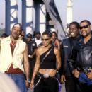 "Members of the Black Knights, including (left to right) Soul Train (Orlando Jones), Half & Half (Salli Richardson-Whitfield), (missing name) and their leader Smoke (Laurence Fishburne) revel in another victory for the ""King of Cali"""