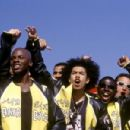 Kid (Derek Luke, front left) and Primo (Rick Gonzalez, front right) and the rest of the Biker Boyz cheer on another racer