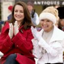 Kelly Finch (Kristin Davis) and new b.f.f. Tia Hall (Kristin Chenoweth) enjoy the holiday festivities. Photo credit: Doane Gregory.