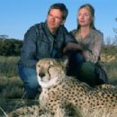 CAMPBELL SCOTT as Peter, HOPE DAVIS as Kristin and his lovable cheetah Duma, in Warner Bros. Pictures family adventure Duma.