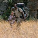 ALEX MICHAELETOS as Xan and EAMONN WALKER as Ripkuna, in Warner Bros. Pictures family adventure Duma.