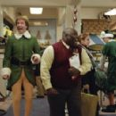 "Will Ferrell (left) stars as ""Buddy"" and Faizon Love stars as ""The Store Manager"" in New Line Cinema's upcoming family comedy, Elf."