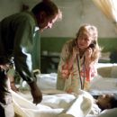 Stellan Skarsgard, Izabella Scorupco and Remy Sweeney in Morgan Creek Productions prequel to The Exorcist, 'Exorcist: The Beginning,' distributed by Warner Bros. Pictures.
