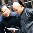 Ronny Yu (left) and Jet Li (right) on the set of JET LI'S FEARLESS a Rogue Pictures release.  Photo by Chen Jinquan.