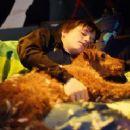 Shane (Josh Hutcherson) sleep with his new friend Rex in Firehouse Dog - 2007