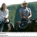 Husband and wife Tom and Nell McLaughlin (Tim McGraw, Maria Bello) survey their expansive Wyoming ranch. Photo Credit: Merrick Morton. © 2006 Twentieth Century Fox.