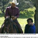 Director Michael Mayer reviews a scene with star Tim McGraw on the set of FLICKA. Photo Credit: Merrick Morton. © 2006 Twentieth Century Fox.