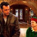 """VINCE VAUGHN as Fred Claus and JOHN MICHAEL HIGGINS as Willie in Warner Bros. Pictures' holiday comedy """"Fred Claus,"""" distributed by Warner Bros. Pictures. The film also stars Paul Giamatti. Photo courtesy of Warner Bros. Pictures"""