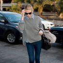 Theron carries two handbags on one arm as she prepares to depart LAX (Los Angeles International Airport