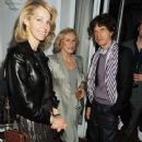 Mick Jagger and L'Wren Scott attend Finch's Quarterly Cannes Dinner 2010 at the Hotel du Cap as part of the 63rd Cannes Film Festival on May 17, 2010 in Antibes, France - 365 x 594
