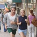 Carly Schroeder and Dermot Mulroney in GRACIE. Photo by K.C. Bailey. © 2007 Picturehouse.