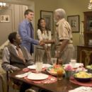 (l to r) Bernie Mac, Ashton Kutcher, Zoë Saldaña and Hal Williams star in Columbia Pictures/Regency Enterprises' new comedy Guess Who. Photo Credit: Claudette Barius, S.M.P.S.P.