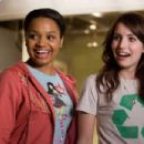 Heather (Kyla Pratt, left), a pet shop employee, helps Andi (Emma Roberts, right) with an ingenious plan to house the town's unwanted stray dogs in the comedy/adventure 'Hotel for Dogs.' Photo Credit: Jaimie Trueblood. © 2008 DreamWorks LLC an