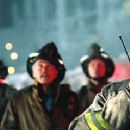 John Travolta as Kennedy in Ladder 49