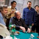 "Director Curtis Hanson, Chau Giang, Jason Lester and John Juanda observe Doyle Brunson in a backstage side game between takes on the set of Warner Bros. Pictures' and Village Roadshow Pictures' ""Lucky You."" The film stars Eric Bana - 454 x 302"