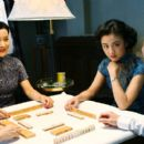 Joan Chen (left), Tang Wei (center) and Tony Leung (right) star in Ang LeeÆs LUST, CAUTION, a Focus Features release.