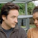 """John Cusack (left) stars as """"David"""" and Sophie Okonedo (right) stars as """"Sophie"""" in New Line Cinema's release of MARTIAN CHILD. Photo Credit: ©2007 New Line Cinema"""