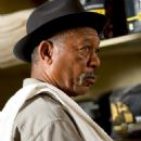 Morgan Freeman as Scrap in Warner Bros. Pictures' drama Million Dollar Baby. The Malpaso production also stars Clint Eastwood and Hilary Swank. Merie W. Wallace