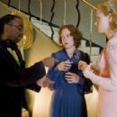 L to R: Bharat Nalluri, Frances McDormand and Amy Adams on the set of Miss Pettigrew Lives for a Day.