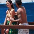 Besotted footballer Neymar packs on the PDA with bikini-clad model girlfriend Bruna Marquezine a few days after rekindling their on/off flame as they enjoy starry hotel party in Brazil