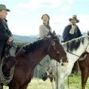 Boss (Robert Duvall, left), Sue (Annette Bening, center), and Charley (Kevin Costner, right) saddle up.