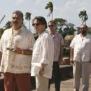 (l to r) General Modrano (JOAQUIN COSIO), Dominic Greene (MATHIEU AMALRIC), Elvis (ANATOLE TAUBMAN), and Lt. Orso (JESUS OCHOA) meet on the Haitian Quayside. Location: Colon, Panama. Photo by: Karen Ballard. Quantum of Solace © 2008 Danjaq, LLC, United Ar - 454 x 321