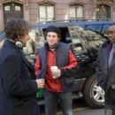 Adam Sandler (left), Director/Writer Mike Binder (center), and Don Cheadle (right) on the set of Columbia Pictures' Reign Over Me. Photo Credit : Tracy Bennett. Copyright© 2006 Sony Pictures Entertainment Inc.. All rights reserved.