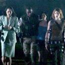 (L-r) Sandrine Holt, Razaaq Adoti, Sienna Guillory and Milla Jovovich in Sony Pictures Entertainment's action/adventure movie 'Resident Evil: Apocalypse.' - 242 x 228