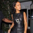 Rihanna shields her eyes from camera flashes as she leaves Il Ristorante di Giorgio Baldi - 385 x 594