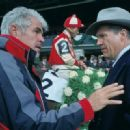 Gary Ross (director) and Jeff Bridges (Charles Howard) on the set of Seabiscuit.