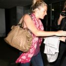 Sienna Miller - Without Makeup But Tanned At LAX Airport In Los Angeles, 31. 3. 2009.