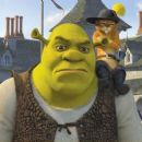 Shrek (voiced by Mike Myers) and Puss-in-Boots (voiced by Antonio Banderas)