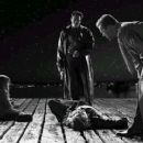 a scene from Dimension Films' Sin City, starring Bruce Willis, Michael Madsen and Nick Stahl