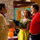 "ROGER ALLAM as Royalton, SUSAN SARANDON as Mom Racer, and JOHN GOODMAN as Pops Racer in a scene from Warner Bros. Pictures' and Village Roadshow Pictures' action adventure ""Speed Racer,"" distributed by Warner Bros. Pictures. Photo"