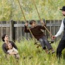 """(L-r) MARY-LOUISE PARKER as Zee James, BROOKLYNN PROULX as Mary James, DUSTIN BOLLINGER as Tim James and BRAD PITT as Jesse James in Warner Bros. Pictures' and Virtual Studios' drama """"The Assassination of Jesse James by the Coward Robert"""