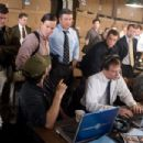 Center from left to right: Sergeant Dignam (MARK WAHLBERG), Captain Ellerby (ALEC BALDWIN) and Colin Sullivan (MATT DAMON) head up the surveillance team, including Brown (ANTHONY ANDERSON, seated far right), that is monitoring a meeting between Costello&#