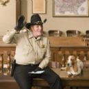M.C. GAINEY as Roscoe P. Coltrane in Warner Bros. Pictures' and Village Roadshow Pictures' action comedy 'The Dukes of Hazzard,' starring Johnny Knoxville, Seann William Scott and Jessica Simpson and distributed by Warner Bros. Pictures. - 454 x 303