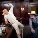 BURT REYNOLDS as Boss Hogg gets it from WILLIE NELSON as Uncle Jesse in Warner Bros. Pictures' and Village Roadshow Pictures' action comedy 'The Dukes of Hazzard,' starring Johnny Knoxville, Seann William Scott and Jessica Simpson and dist