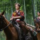 Jason Tripitikas (Michael A. Angarano) and Golden Sparrow (Crystal Liu) in THE FORBIDDEN KINGDOM. Photo credit: Chan Kam Chuen