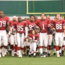 Morris Chestnut, Madison Pettis and The Rock in the scene of The Game Plan.