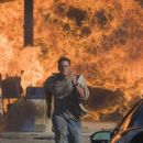 As a gasoline station/convenience mart turns into an inferno, John Triton (John Cena) races after his wife's kidnappers in THE MARINE. Photo credit: Vince Valitutti.