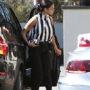 Selena Gomez stops by an office dressed like a referee in Los Angeles, California on August 5, 2014