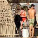 Lindsay Lohan – In red swimsuit on Mykonos Island - 454 x 303