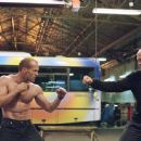 Jason Statham as Frank Martin busting out deadly street fighting and martial arts skills against a formidable opponent in 20th Century Fox's The Transporter - 2002