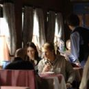 Emily Mortimer, who plays Jessie, and Woody Harrelson,  who plays Roy, sit down to a meal on the Transsiberian train with Sir Ben Kingsley. Photo credit: José Haro, courtesy of First Look Studios.