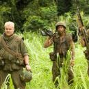L to R: Robert Downey Jr., Jack Black, Brandon T. Jackson, Jay Baruchel and Ben Stiller in the scene of Tropic Thunder.