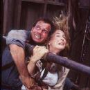 Bill Paxton and Helen Hunt brace against the storm in a scene from Twister.