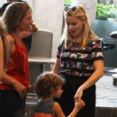 Actress and busy mom Reese Witherspoon chats with a friend while enjoying a party in Brentwood, California with her family on June 28, 2015